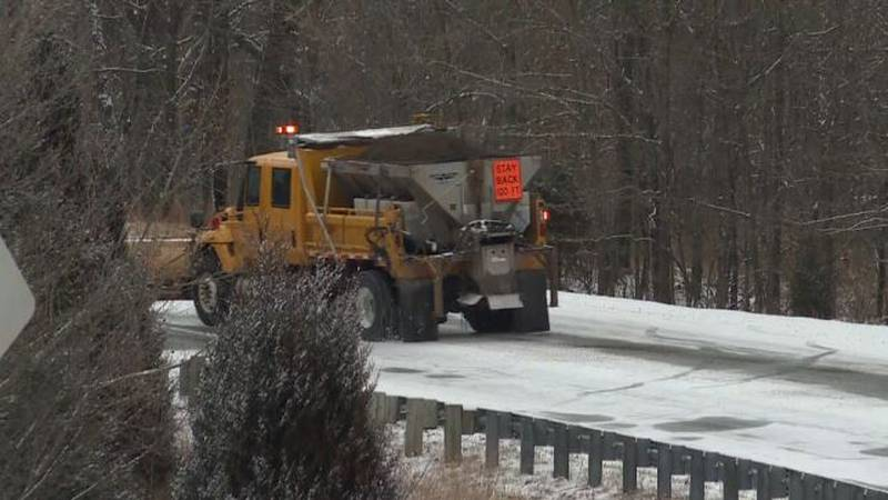 A MoDOT snow plow is seen clearing a road in Camden County in January 2020.