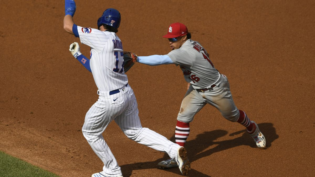 St. Louis Cardinals second baseman Kolten Wong, right, tags out Chicago Cubs' Kris Bryant between first base and second base during the second inning of a baseball game Monday, Sept. 7, 2020, in Chicago. (AP Photo/Paul Beaty)