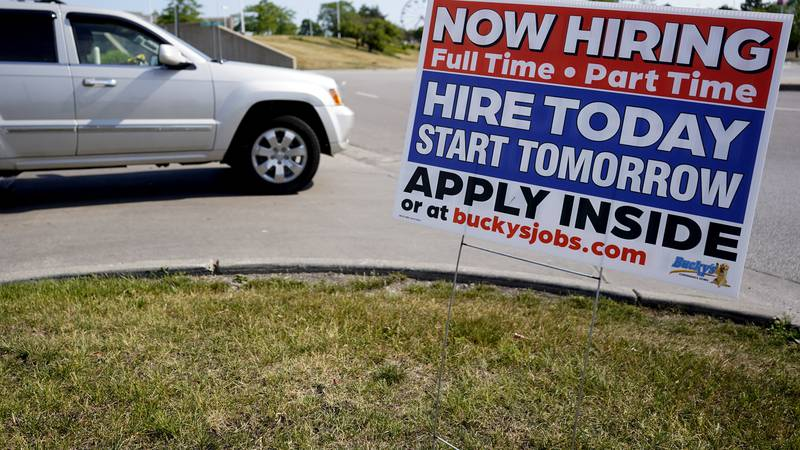 FILE - A hiring sign shows in Vernon Hills, Ill., Friday, June 11, 2021.