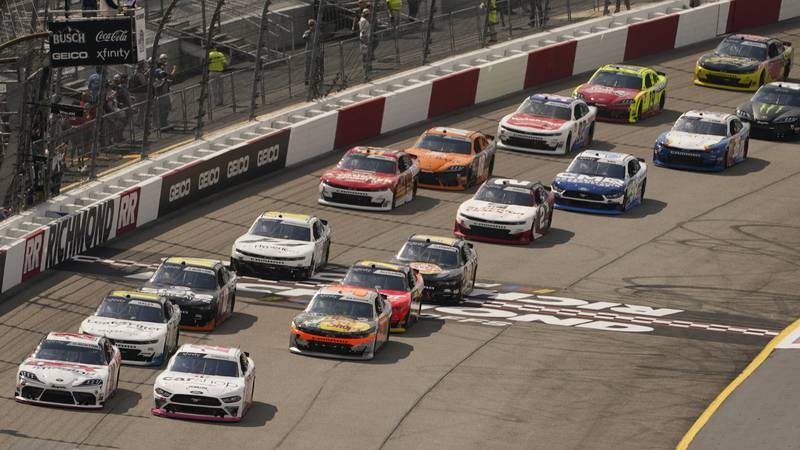 Harrison Burton (20) and Austin Cindric (22) lead the field at the start of the NASCAR Xfinity...