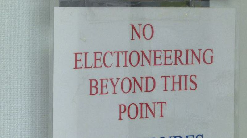 """A sign reading """"No Electioneering Beyond This Point"""" hangs in the hallway outside the Camden..."""