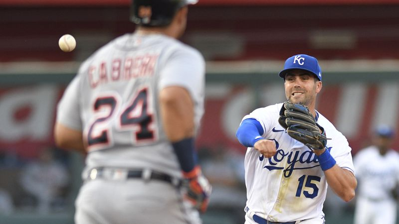 Kansas City Royals second baseman Whit Merrifield throws to first after forcing out Detroit...
