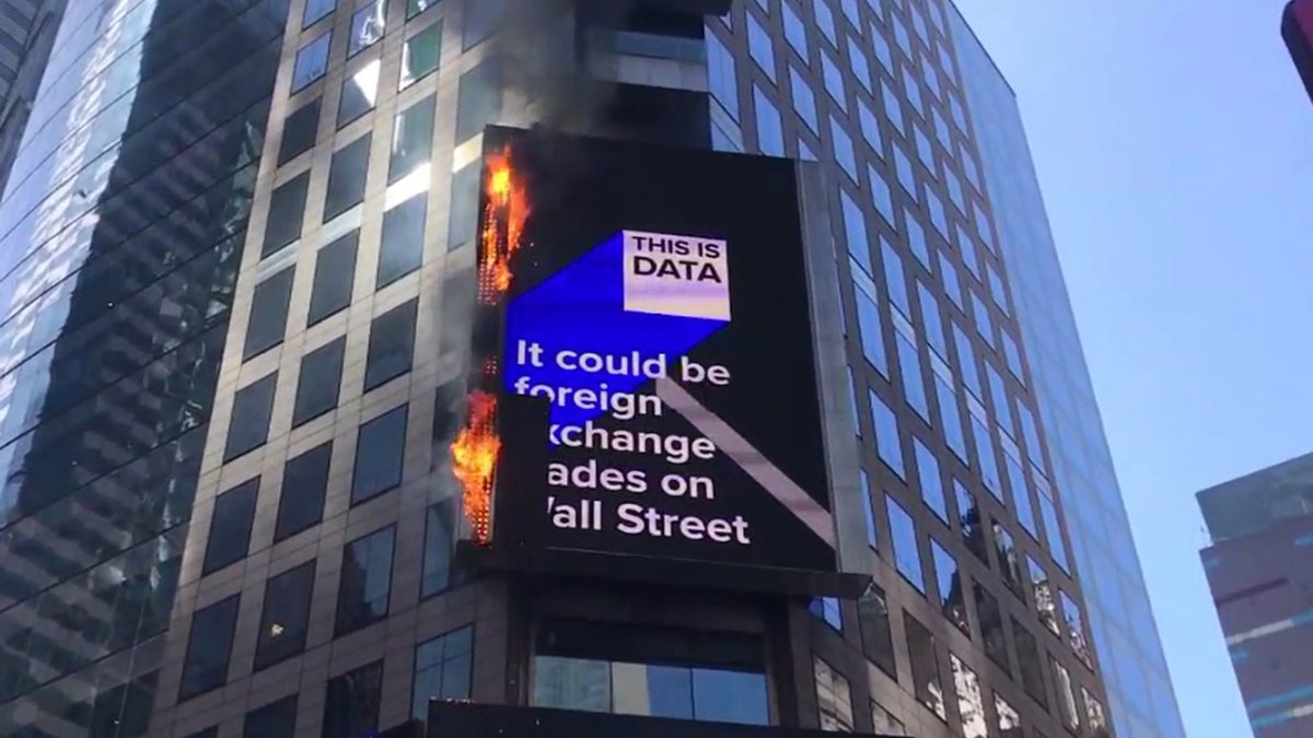 In this image from video provided by WABC TV, flames shoot from the digital billboard at 3...