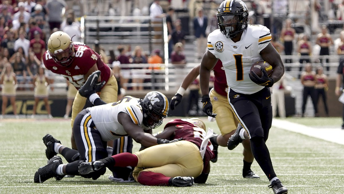 Missouri running back Tyler Badie (1) breaks free from the pile as he rushes for a gain during...
