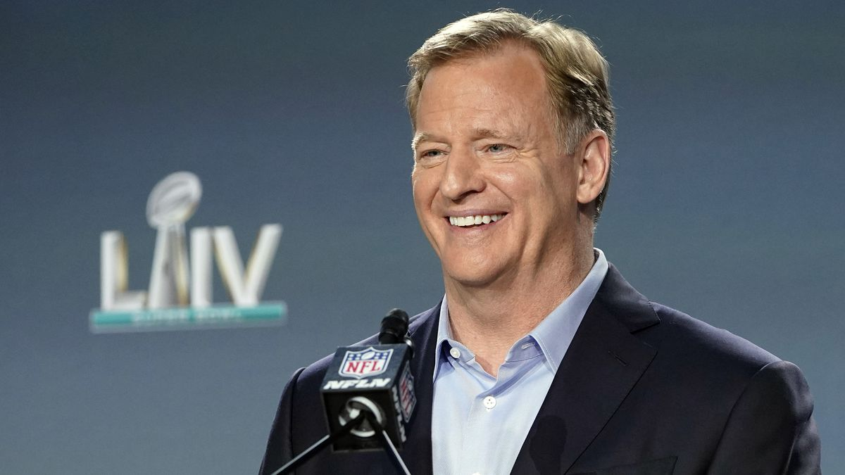 """In this Jan. 29, 2020, file photo, NFL Commissioner Roger Goodell smiles before answering a question during a news conference for the NFL Super Bowl 54 football game in Miami. Goodell has sent a letter to fans outlining the league's plans to play during the coronavirus pandemic. As veterans begin reporting to training camps this week, Goodell noted Monday, July 27, 2020, how COVID-19 has """"turned the world upside down."""""""