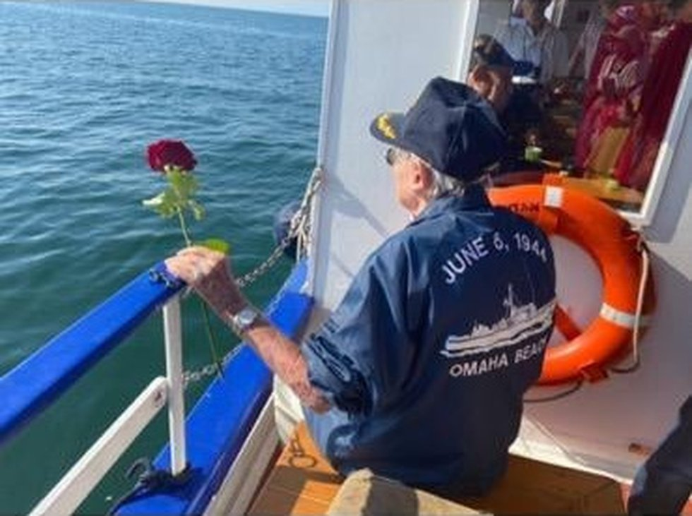 Jack Hamlin presents a dozen roses in remembrance of the Rangers on Pointe du Hoc on D day,