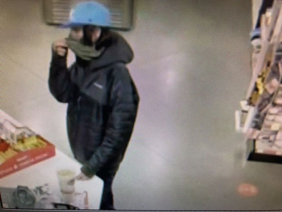 The man paid with a credit card stolen near Carver Middle School.