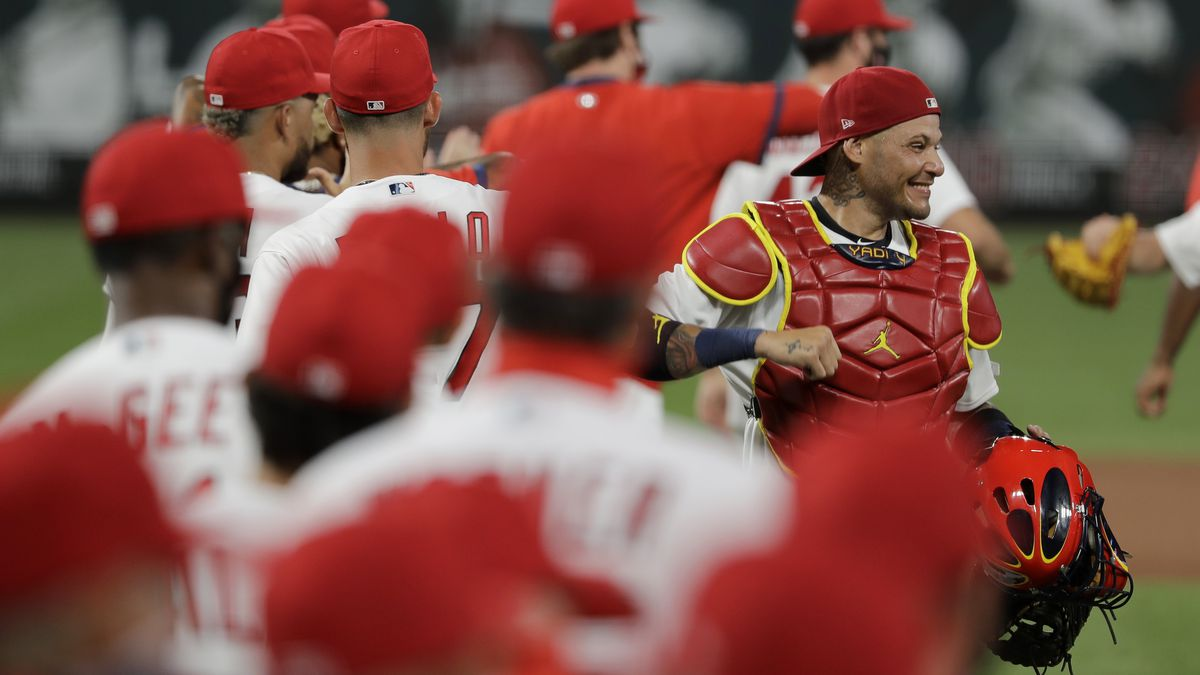 St. Louis Cardinals catcher Yadier Molina, right, celebrates a 5-4 victory over the Pittsburgh Pirates in a baseball game Friday, July 24, 2020, in St. Louis. (AP Photo/Jeff Roberson)