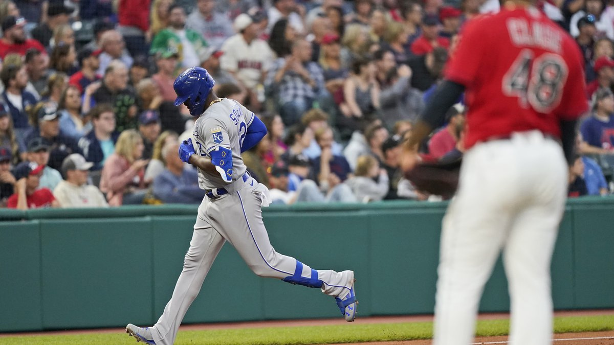 Kansas City Royals' Jorge Soler, left, runs the bases after hitting a solo home run as...