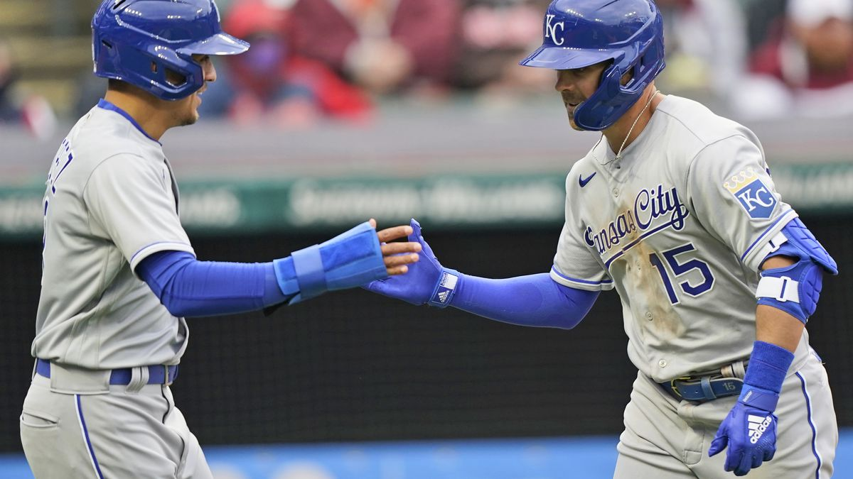 Kansas City Royals Whit Merrifield, right, is congratulated by Nicky Lopez after Merrifield hit...