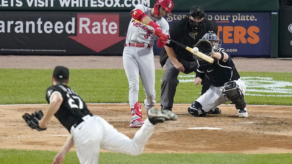 St. Louis Cardinals' Dylan Carlson hits a sacrifice fly off Chicago White Sox starting pitcher...