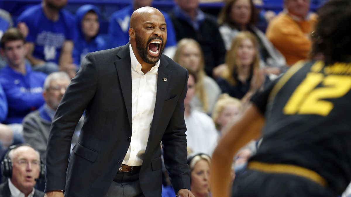 Missouri head coach Cuonzo Martin yells to his team during the first half of an NCAA college...