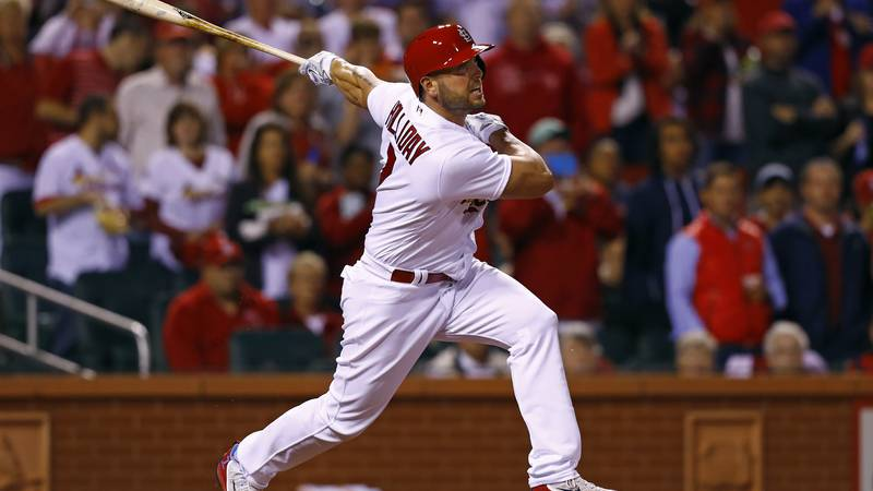 St. Louis Cardinals' Matt Holliday watches his home run to right field during the seventh...