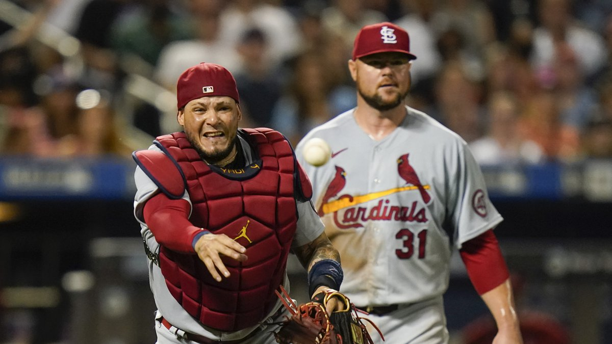 St. Louis Cardinals starting pitcher Jon Lester, right, watches as catcher Yadier Molina throws...