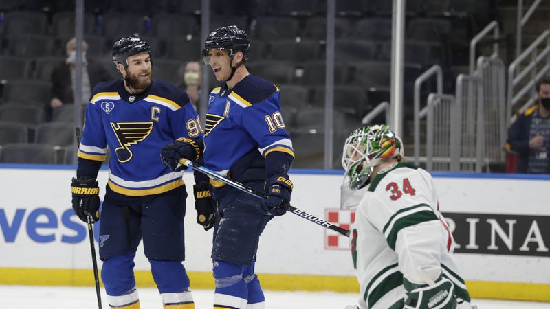 St. Louis Blues' Brayden Schenn (10) celebrates his goal with Ryan O'Reilly (90), as Minnesota...