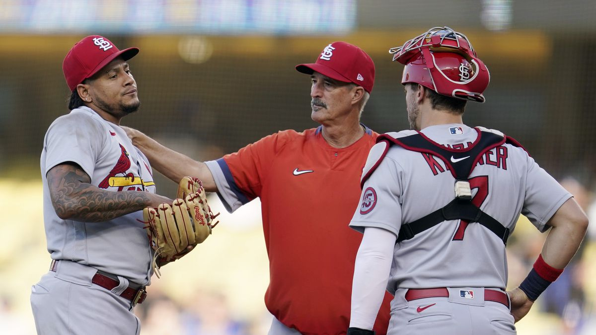 St. Louis Cardinals starting pitcher Carlos Martinez, left, gets a visit to the mound from...