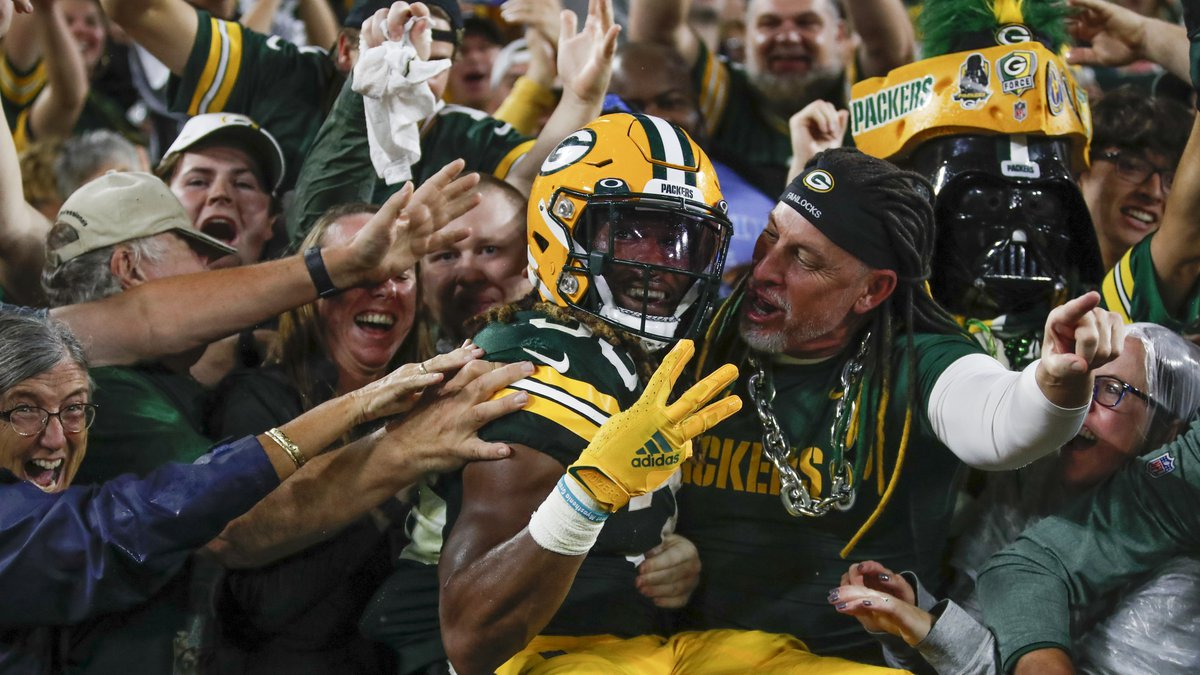 Green Bay Packers' Aaron Jones celebrates his touchdown run during the second half of an NFL...