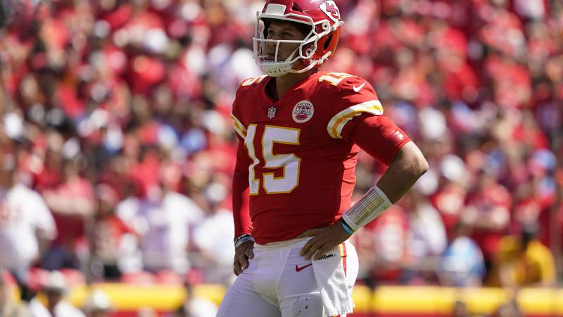 Kansas City Chiefs quarterback Patrick Mahomes (15) watches during the first half of an NFL...