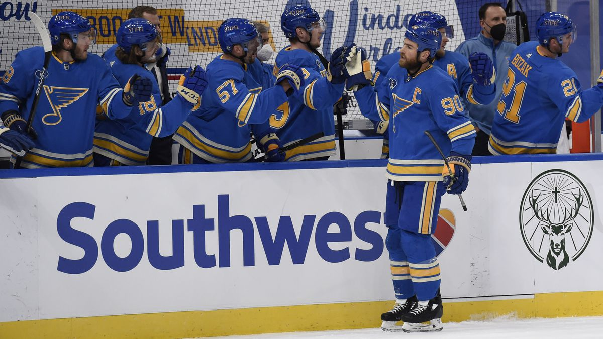 St. Louis Blues' Ryan O'Reilly (90) is congratulated by teammates after scoring a goal against...