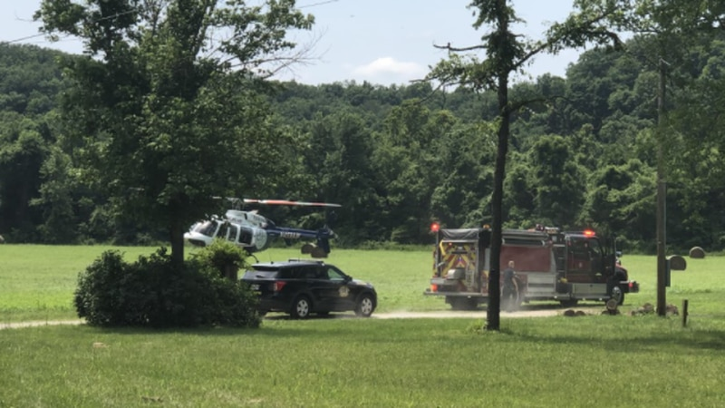 A helicopter and several emergency crews responded to a rescue operation at a field Monday in...