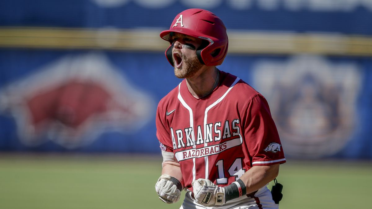 Arkansas' Cullen Smith celebrates after hitting a two-run home run against Tennessee in the...