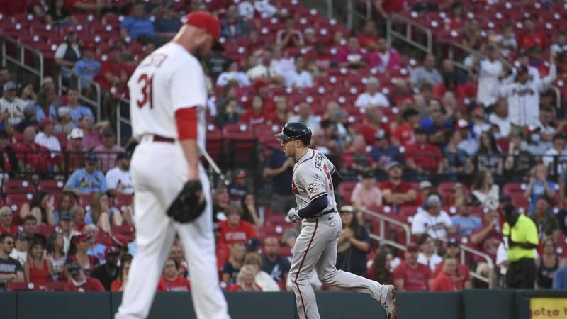 St. Louis Cardinals starting pitcher Jon Lester walks off the mound after giving up a home run...