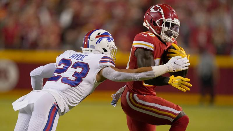 Kansas City Chiefs wide receiver Tyreek Hill, right, runs with the ball as Buffalo Bills safety...