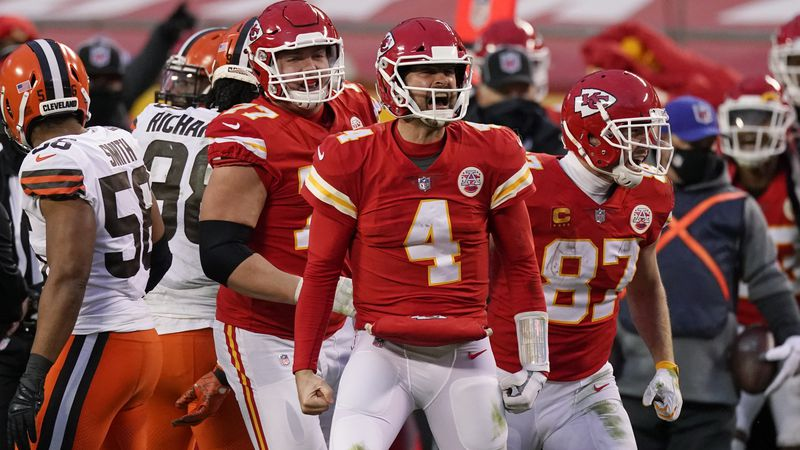 Kansas City Chiefs quarterback Chad Henne celebrates after a run during the second half of an...