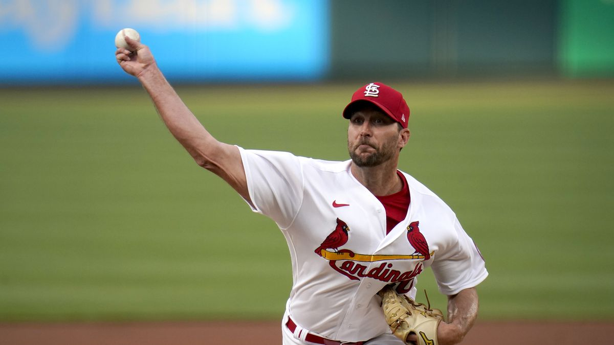 St. Louis Cardinals starting pitcher Adam Wainwright throws during the first inning of a...