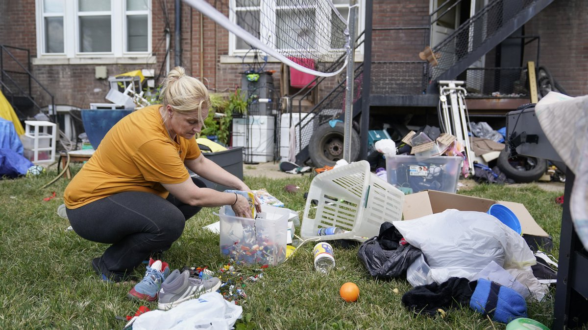 Kristen Bigogno gathers up some of her belongings while being evicted from her home Friday,...