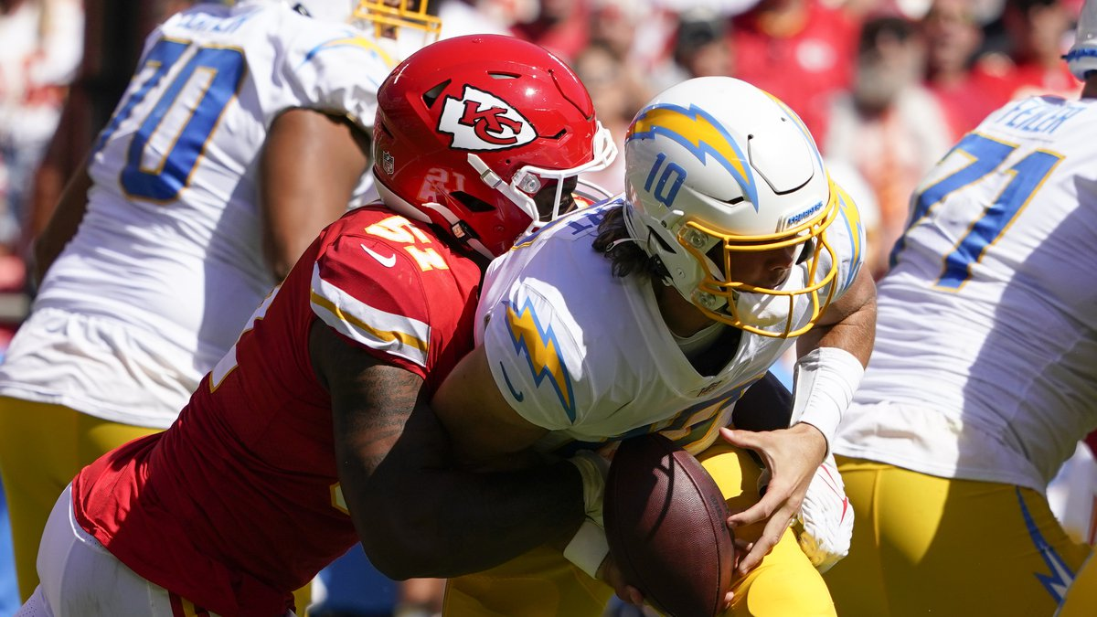 Los Angeles Chargers quarterback Justin Herbert (10) is sacked by Kansas City Chiefs' Michael...