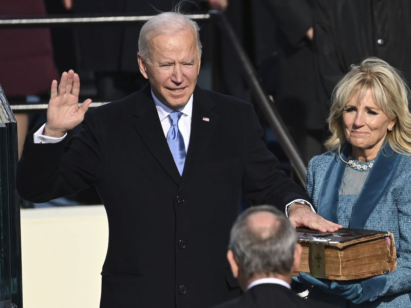 Joe Biden is sworn in as the 46th president of the United States by Chief Justice John Roberts...