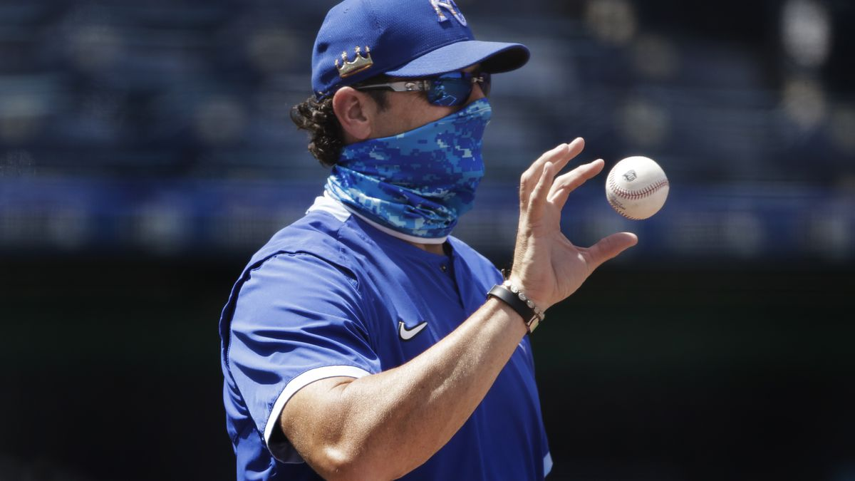 Kansas City Royals manager Mike Matheny catches a ball during baseball practice at Kauffman Stadium on Thursday, July 9, 2020, in Kansas City, Mo. (AP Photo/Charlie Riedel)