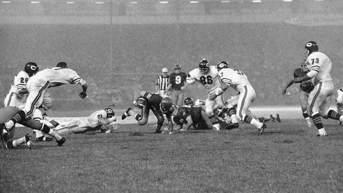 Gerry Allen, 20, a running back for the Washington Redskins, slips on the rainy turf during...