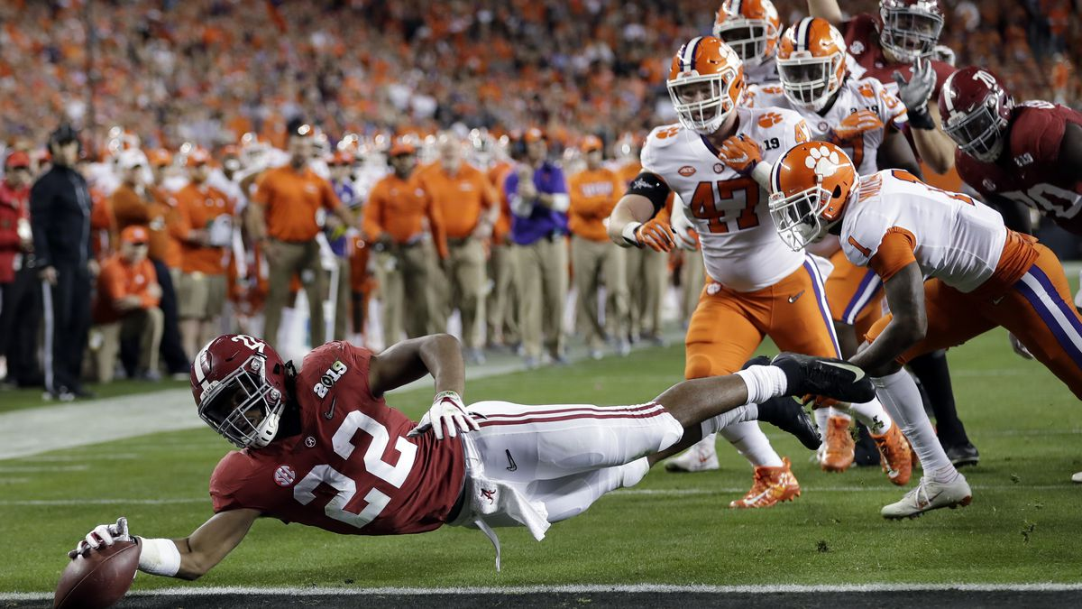 FILE - In this Jan. 7, 2019, file photo, Alabama's Najee Harris reaches for the end zone during the first half the NCAA college football playoff championship game against Clemson, in Santa Clara, Calif. After the Power Five conference commissioners met Sunday, Aug. 9, 2020, to discuss mounting concern about whether a college football season can be played in a pandemic, players took to social media to urge leaders to let them play.(AP Photo/David J. Phillip, File)