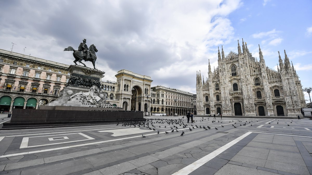 Pigeons took posses of Duomo square in Milan, Italy, Sunday, March 15, 2020, as most people...