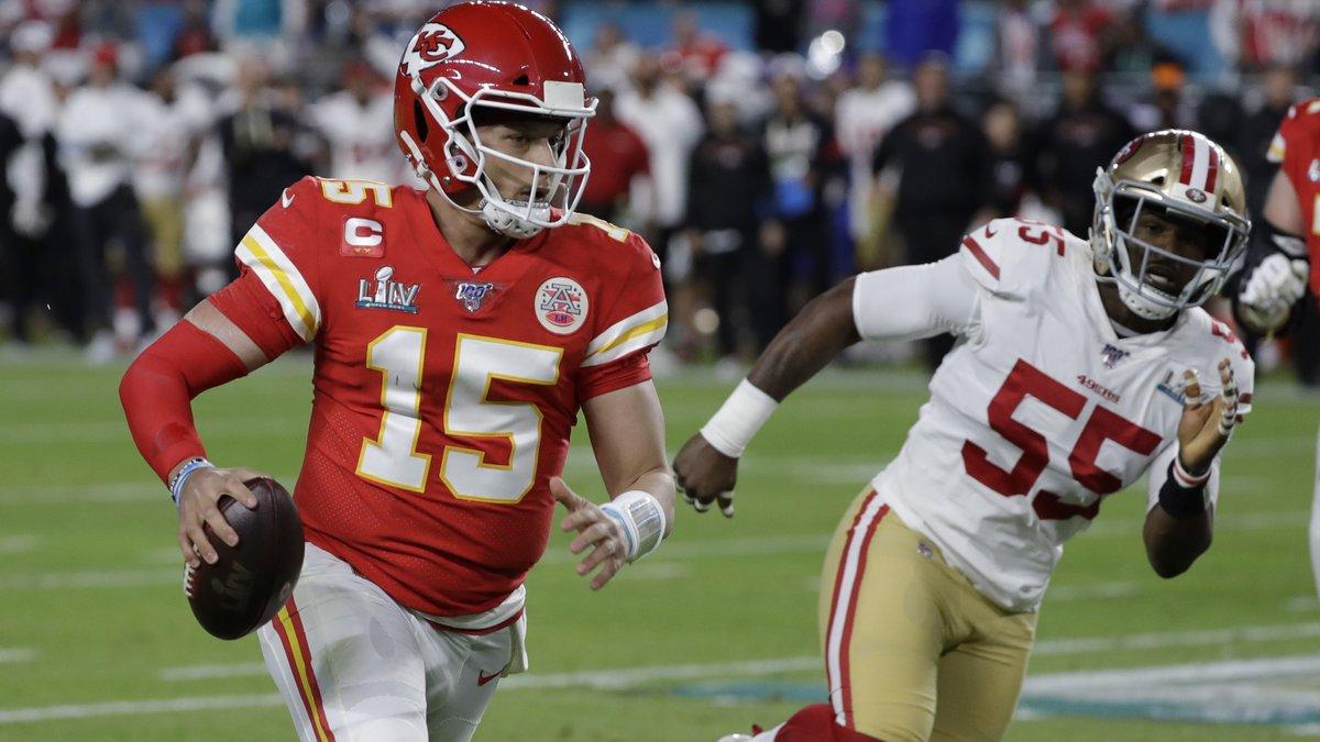 Kansas City Chiefs quarterback Patrick Mahomes (15) runs in front of San Francisco 49ers' Dee...