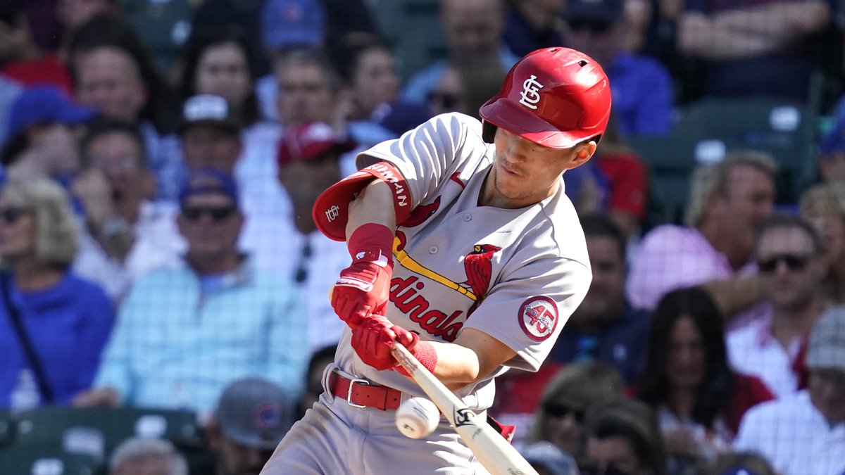 St. Louis Cardinals' Tommy Edman hits a one-run single during the sixth inning in the first...