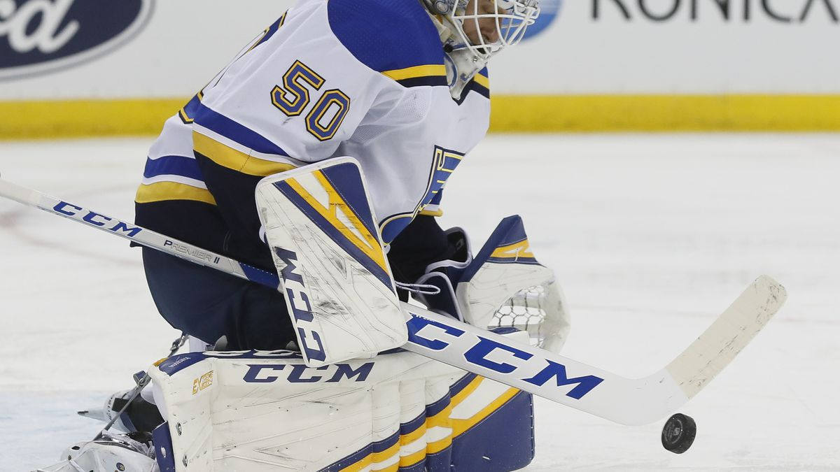 St. Louis Blues goaltender Jordan Binnington makes a save during the second period of an NHL hockey game against the New Jersey Devils, Friday, March 6, 2020, in Newark. (AP Photo/John Minchillo)