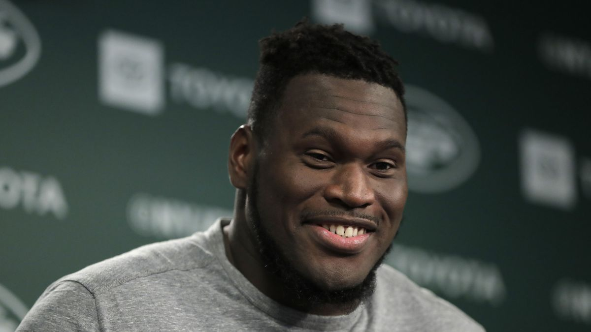 FILE - In this June 4, 2019, file photo, New York Jets offensive guard Kelechi Osemele speaks to reporters at the team's NFL football training facility in Florham Park, N.J. The Kansas City Chiefs have had two players opt out of the upcoming season because of COVID-19. But with the signing of veteran guard Kelechi Osemele, and some key offseason acquisitions at both spots, there may be no positions for which the Chiefs are better able to absorb those losses as they head into training camp.(AP Photo/Julio Cortez, File)