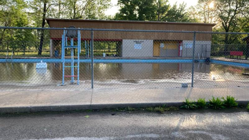 A recent flood caused a nearby creek and pond to rise filling the pool with mud and debris.