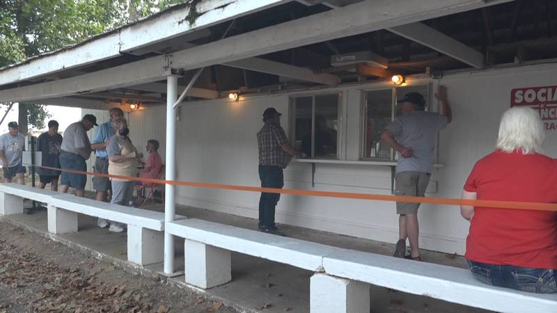 People line up for chicken dinners at the 69th annual Crane Broiler Festival.