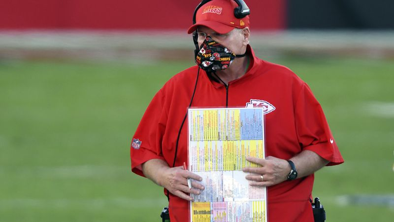 Kansas City Chiefs head coach Andy Reid wears a protective face mask during the first half of...