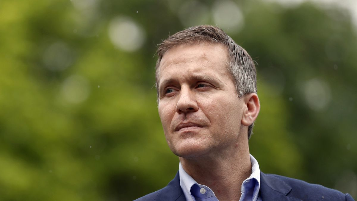 FILE - In this May 17, 2018 file photo, Missouri Gov. Eric Greitens looks on before speaking at an event near the capitol in Jefferson City, Mo. Greitens, a sometimes brash outsider whose unconventional resume as a Rhodes Scholar and Navy SEAL officer made him a rising star in Republican politics, abruptly announced his resignation Tuesday, May 29, 2018, after a scandal involving an affair with his former hairdresser led to a broader investigation by prosecutors and state legislators. (AP Photo/Jeff Roberson, File)