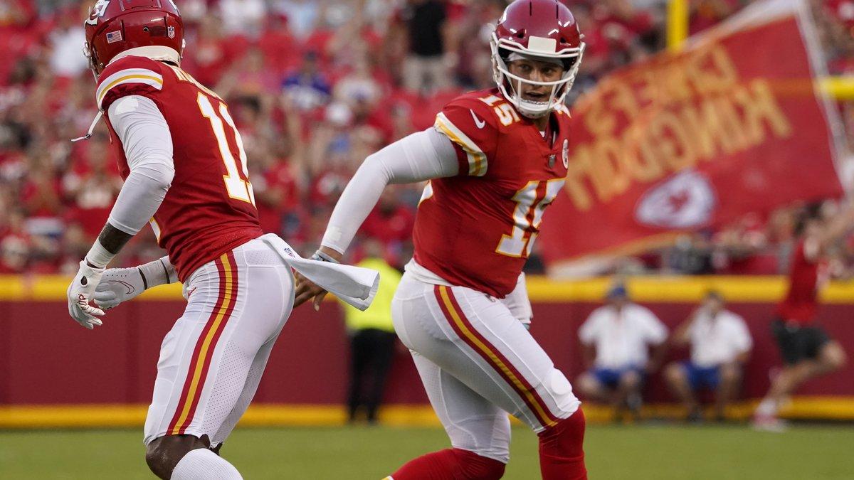 Kansas City Chiefs quarterback Patrick Mahomes, right, celebrates with Demarcus Robinson after...
