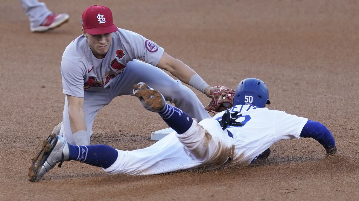 Los Angeles Dodgers' Mookie Betts (50) is caught stealing second by St. Louis Cardinals second...