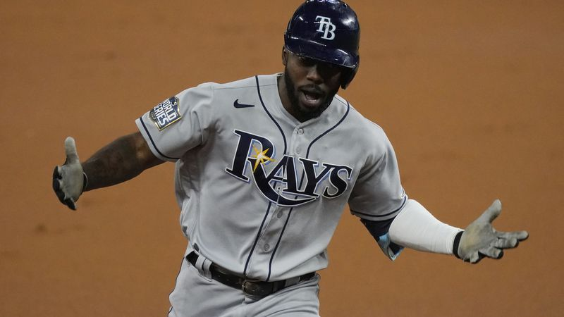 Tampa Bay Rays' Randy Arozarena celebrates a home run during the first inning in Game 6 of the...