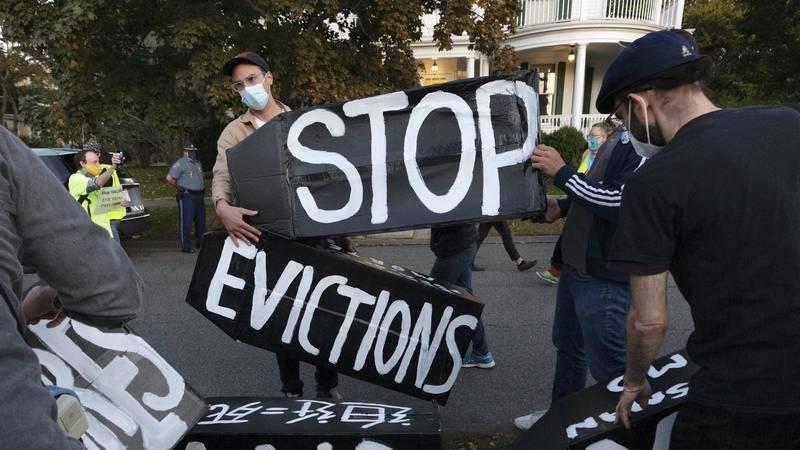 FILE - In this Oct. 14, 2020, file photo, housing activists erect a sign in Swampscott, Mass. A...