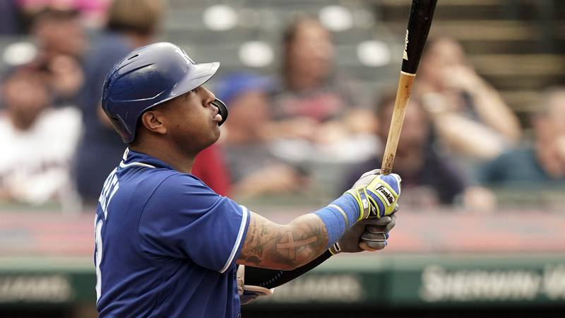 Kansas City Royals' Salvador Perez watches his two-run home run in the fifth inning in the...