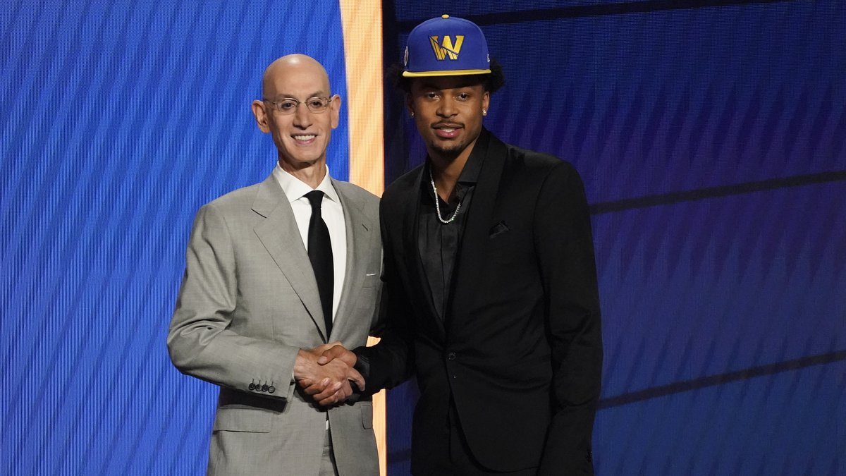 Moses Moody poses for a photo with NBA Commissioner Adam Silver after being selected 14th...